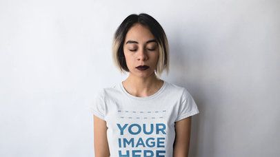 Edgy Girl With Paper Airplane Circling Her Head Wearing a Round Neck Tee Stop Motion Mockup a13604