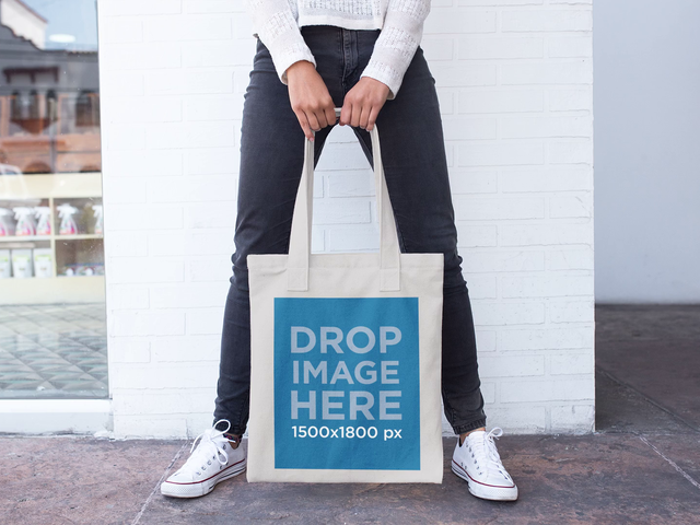 Girl Changing her Pose While Holding a Tote Bag Stop Motion Mockup a13641