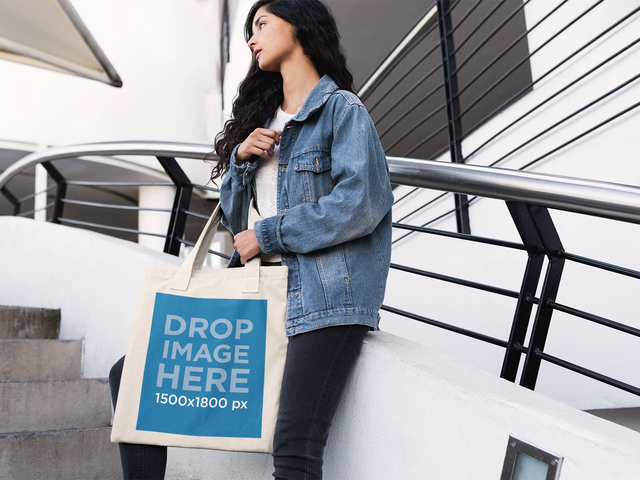 Stop Motion Mockup of a Pretty Girl Holding Her Tote Bag in Stairways a13644