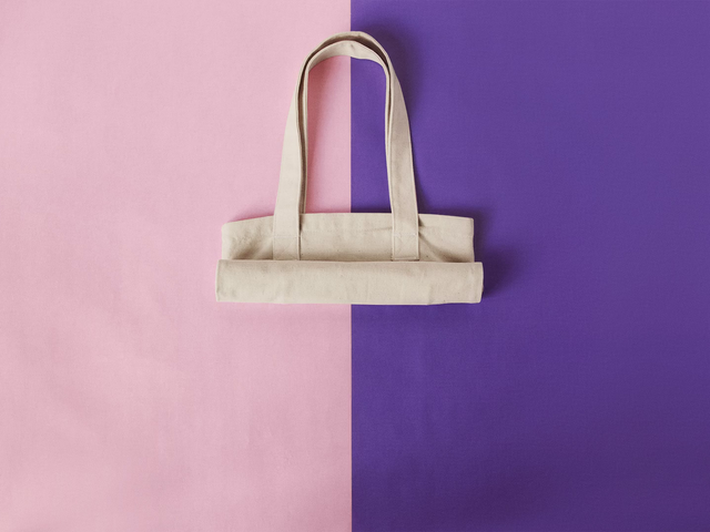 Stop Motion Mockup of a Tote Bag Rolling Over a Pink and Purple Background a13667
