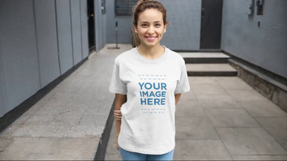 Video Mockup of a Young Woman Wearing a Round Neck Tee Holding Her Arm Behind Her Back a13049