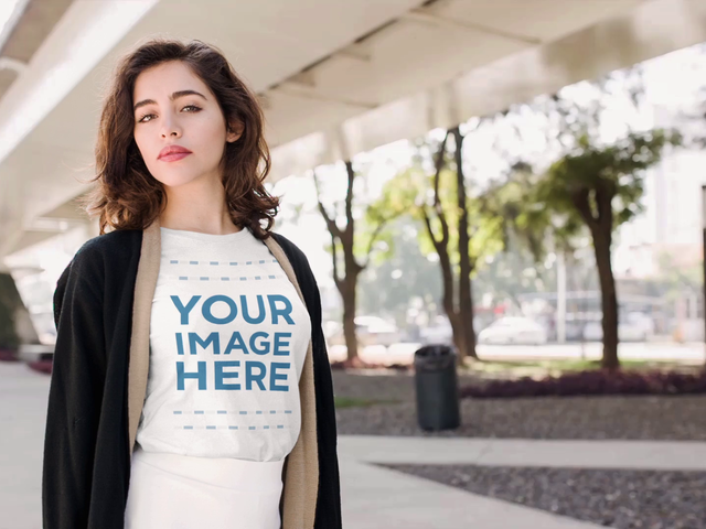 Beautiful Young Girl Wearing a Round Neck Tee On Urban Environment Cinemagraph Mockup a13594
