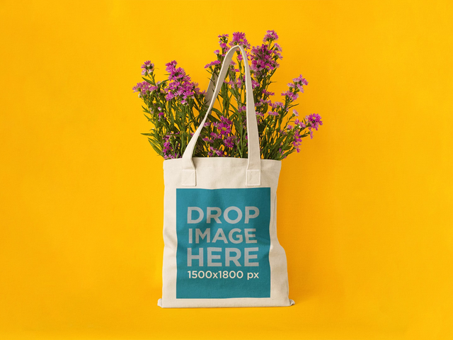 Stop Motion Mockup of a Tote Bag With Flowers Yellow Background c13666