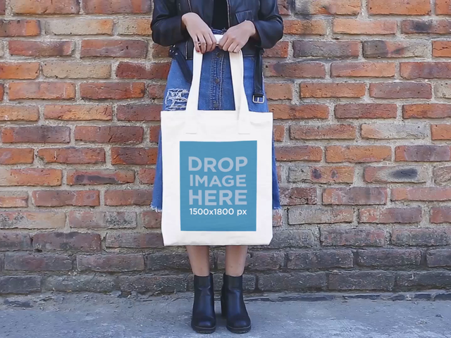 Girl Holding A Tote Bag While Standing Wearing Boots And Dress Video Mockup a13760