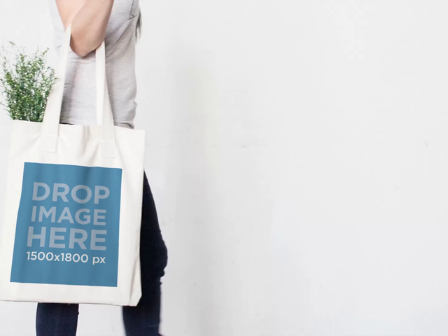 Tote Bag Being Held By Girl Returning From Shop Against White Wall Stop Motion Mockup a13762