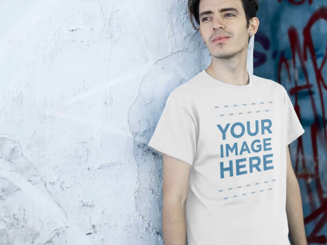 Video Mockup Of A Young Trendy Man Leaning Against An Old Wall Wearing a T-Shirt a12863
