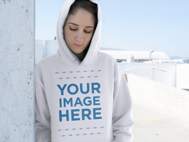 Beautiful Young Woman Wearing a Pullover Hoodie Video Mockup a13190