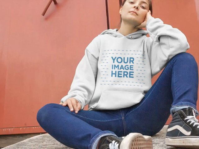 Woman Sitting Down With Legs Open Wearing A Hoodie Video Mockup a13116