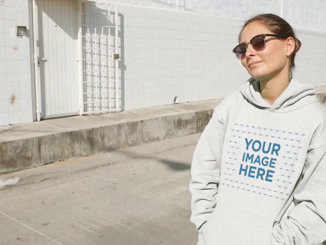 Woman Wearing Hoodie And Sunglasses Sitting On Bumper Industrial Street Mockup Video a13095