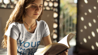 Beautiful Girl Wearing a Round Neck TShirt While Holding A Book With Moving Pages a13319