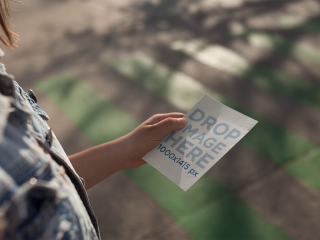 Stop Motion Girl Walking While Holding A Flyer Mockup a13753