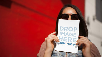 Trendy Girl Holding Flyer On Nose Without Hands Stop Motion Mockup a13737