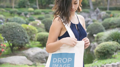 Amazing Mockup Video Of Pretty Young Woman Carrying A Tote Bag While At The Park a13878