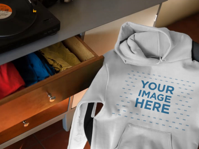 Cinemagraph Of A Hoodie Lying On Chair While Turntable Spinning Mockup a13135