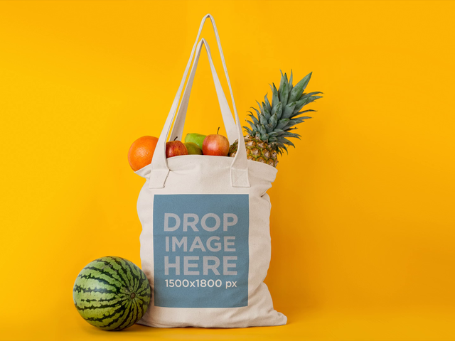 Tote Bag Stop Motion With Fruits Disappearing From It Mockup Against Yellow Background a13711