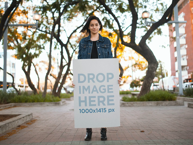 Stop Motion Mockup Of A Young Trendy Girl Holding A Big Poster Going Back And Forth a13736
