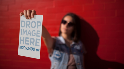 Stop Motion Mockup Of A Woman Playing To Be A Mannequin While Holding A Flyer Near A Red Wall a13741