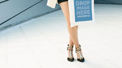 Video Of Beautiful Woman Holding A Tote Bag While In The City Mockup a13908