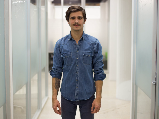 Millenial Guy With Moustache Wearing Denim Jacket Shows You A Business Card Stop Motion Mockup a13730