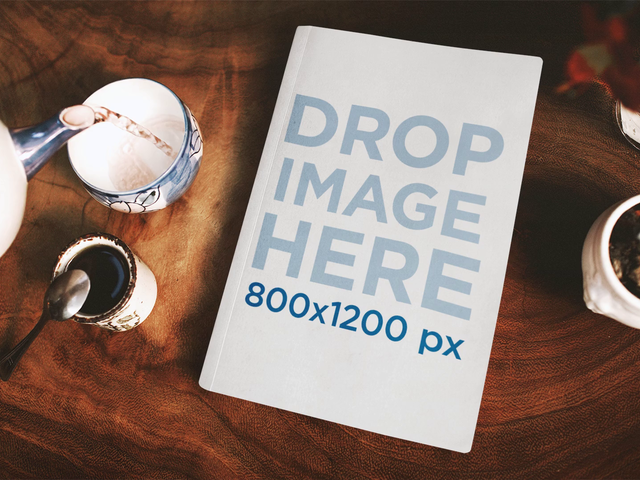Book Lying On Wooden Table While Serving Tea Stop Motion Mockup a13827