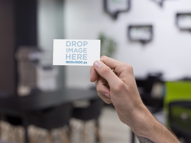 Close Up Of A Business Card Being Held By A Hand At An Office Stop Motion Mockup a13728