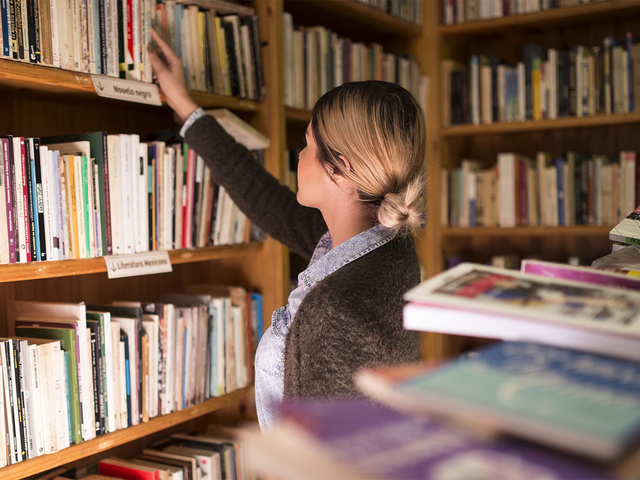 Stop Motion Of Girl Picking Up Book From Library Mockup a13744