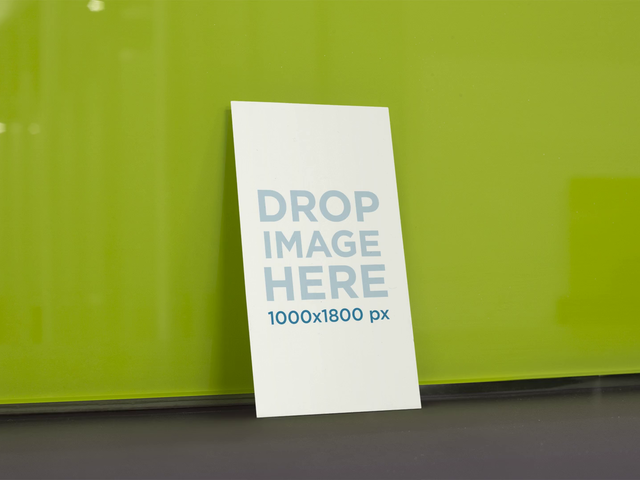 Standing Business Card On Stop Motion Falling From Green Wall Mockup a13706
