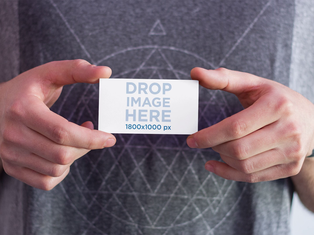 Stop Motion Mockup Of A Guy Holding A Business Card That Magically Dissapears a13784