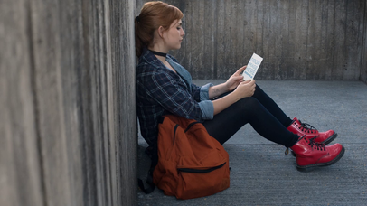 Video Mockup Of A Redhaired Pretty Girl Sitting Down While Holding A Flyer a13896