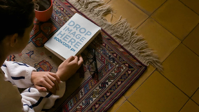Video Of A Happy White Girl Reading A Book While Lying On The Floor Mockup a13972