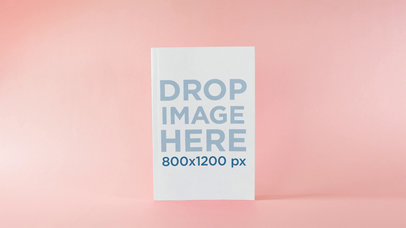 Book Standing Over A Pink Surface With A Pink Background Close Up Mockup Stop Motion a13674