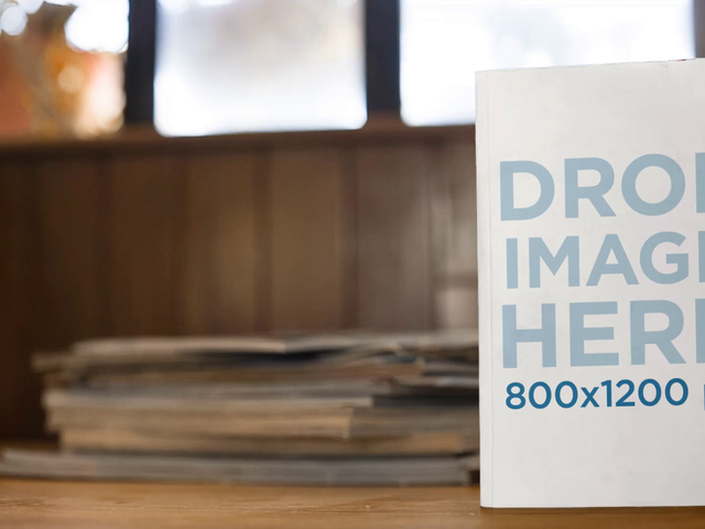 Video Of A Book Standing On A Table Against Books With A Fan On The Background Mockup a14020