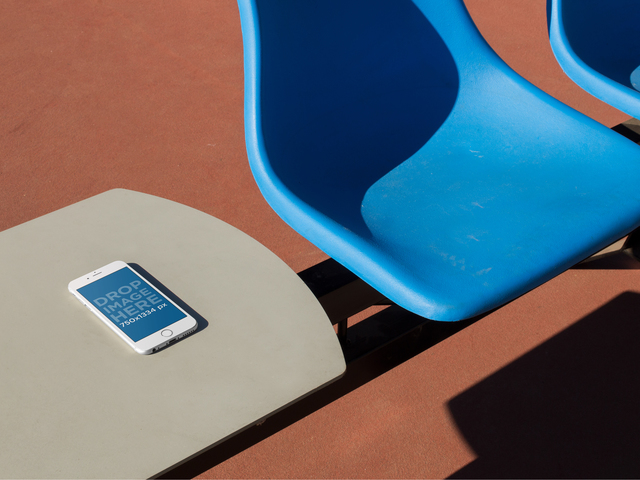 White iPhone 6 Lying Over A White Table Near A Blue Plastic Chair Mockup a14095