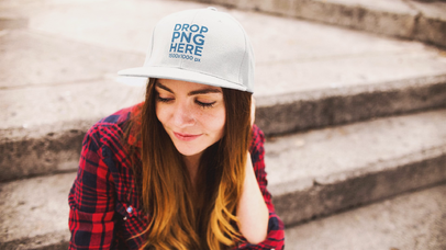 Young White Girl Sitting Down In Concrete Stairways Outdoors While Wearing A Hat Stop Motion Mockup a13701