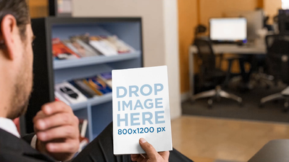 White Man Taking A Look At A Book While Sitting Down In A Library Lobby Mockup Video a14148
