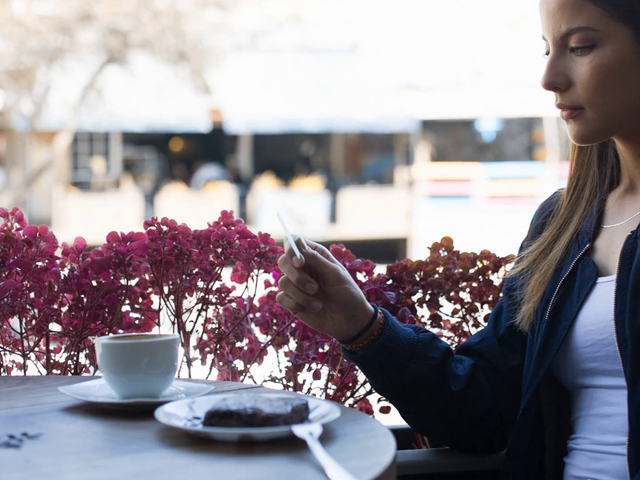 Video Mockup of a Gorgeous Young Woman Looking at a Business Card While at a Cafe a13947