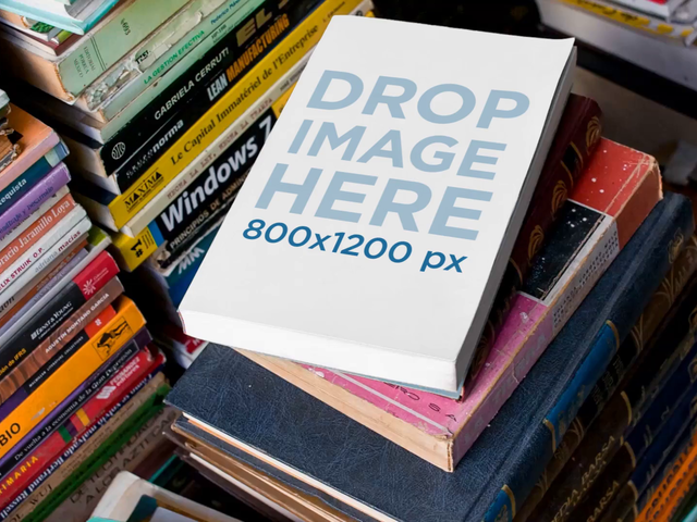 Video Hovering over a Book Lying over a Pile of Books Mockup a13952