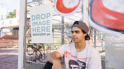 Poster Glued To A Bus Stop With Graffities While A Young Skater Guy Sitting Next To It Mockup Video a13899