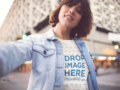 Mockup Selfie Featuring a Girl Wearing a Tshirt With a Denim Jacket On Top In The City a13573