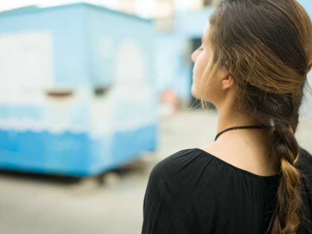 Young Pretty Girl Walking Puts A Poster In A Foodtruck Video Mockup a13876