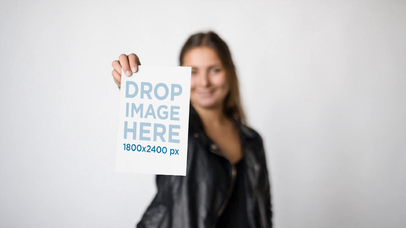 Rocker Girl Wearing a Leather Jacket Shows Your a Flyer While Against a White Background Video Mockup a13811