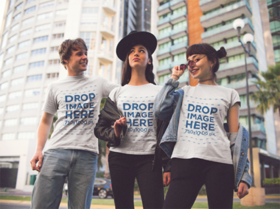 Three Friends Wearing a Tshirt While Hanging out in the City Mockup a13385