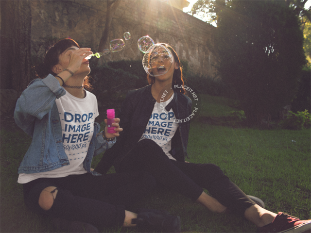 Friends Mockups Two Girls Playing with Bubbles While Hanging out at a Park Wearing Same T-Shirts a13389