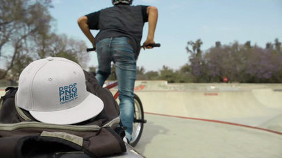 Video Mockup of a Biker Boy in a Skatepark Leaving His Snapback Hat on His Backpack a14195