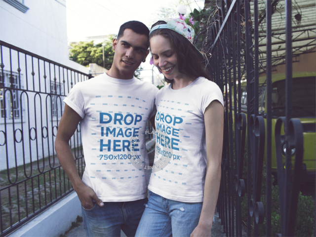 Young Couple of Friends Hanging out and Wearing Same Tshirts in the Street Mockup a13458