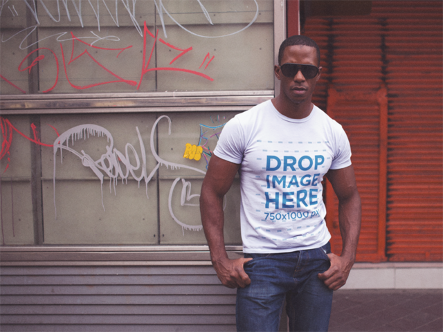 Mockup of a Black Man Wearing a Round Neck Tshirt and Sunglasses While at the City a14232