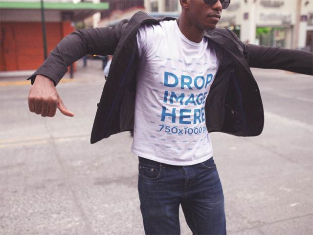 Serious Black Man Getting Ready While Wearing a Round Neck Tshirt and Sunglasses in the City Mockup a14248