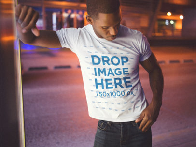 Template of a Black Man Lying Against a Bus Stop Mupi While Wearing a T-Shirt a14234
