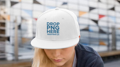 Mockup Video of a Young Woman Wearing a Snapback Hat While in the City a14143