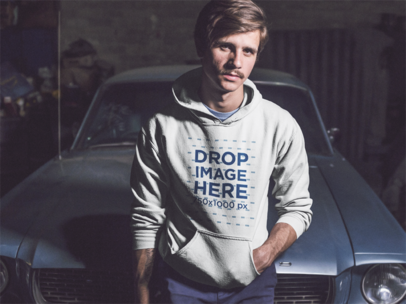 Serious Young Man Wearing a Pullover Hoodie While Sitting Against a Vintage Mustang Mockup a13615